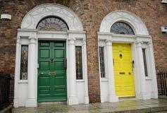 Dublin Georgian doors. Green and yellow Georgian Dublin doors royalty free stock images