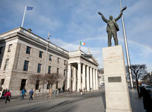 Dublin GPO, Larkin statue and Spire. Statue of Jim Larkin, a Trade Union leader , in front of Dublin General Post Office on O'Connell Street. The modern Spire Stock Image