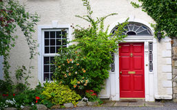 Dublin house. House facade with classical red door, plants and flowers. Dublin, Irland Stock Image
