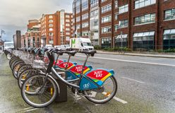 Dublin, Ireland – January 2019 City bikes ready to pickup on bike station in Dublin area, morning hours stock images