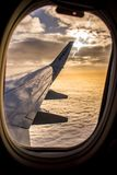 DUBLIN, IRELAND - APRIL 23, 2017: Ryanair logo in the wing of the airplane with sky as the background. Ryanair has cheap flights. Ryanair has cheap but stock image