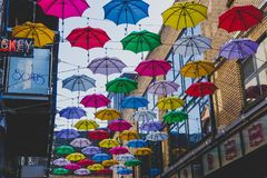 Colorful umbrellas art installation in frot of the Zozimus bar i. DUBLIN, IRELAND - April 14th, 2018: colorful umbrellas art installation in frot of the Zozimus Royalty Free Stock Photography