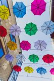 Colorful umbrellas art installation in frot of the Zozimus bar i. DUBLIN, IRELAND - April 14th, 2018: colorful umbrellas art installation in frot of the Zozimus Stock Image