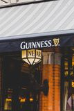 Detail of Irish pub awning with Guinness logo and a lap with Nea. DUBLIN, IRELAND - April 12th, 2018: detail of Irish pub awning with Guinness logo and a lap Royalty Free Stock Images