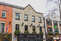 Pubs in the Temple Bar neighbourhood of Dublin city centre. DUBLIN, IRELAND - April 12th, 2018: pubs in the Temple Bar neighbourhood of Dublin city centre, the Stock Photography