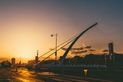 View of Dublin`s famous Samuel Beckett Bridge over the river Lif. DUBLIN, IRELAND - April 30th, 2018: view of Dublin`s famous Samuel Beckett Bridge over the Royalty Free Stock Photo