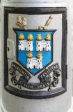 Coat of Arms of Dublin City, Ireland. Dublin, Ireland - August 7, 2017: Coat of Arms fresco colorfully edged on every historic lantern of the city. Shows three Stock Photography
