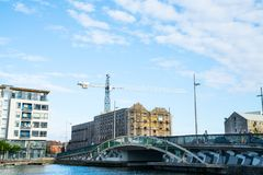 Grand Canal, Dublin. DUBLIN, IRELAND - AUGUST 9, 2017; Grand Canal Bridge at Pearse Street and old Bolands Flourmills across bridge currently being redeveloped Royalty Free Stock Images