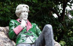 Oscar Wilde. Dublin, Ireland August 17, 2018: Sculpture of writer Oscar Wilde in Merrion Square. The artwork by Danny Osborne was unveiled in 1997. The art shows royalty free stock photo