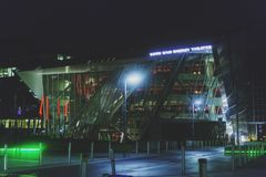 The Bord Gais Theatre and surrounding are with green and red lights at night. DUBLIN, IRELAND - December 9th, 2017: The Bord Gais Theatre and surrounding are royalty free stock photo