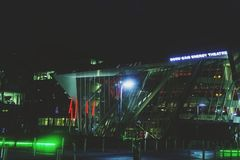 The Bord Gais Theatre and surrounding are with green and red lights at night. DUBLIN, IRELAND - December 9th, 2017: The Bord Gais Theatre and surrounding are royalty free stock photos