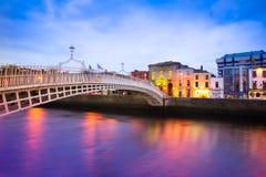 Dublin Ireland at Dusk. With waterfront and historic Ha'penny Bridge Stock Photos