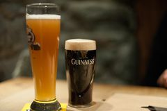 Tiny Guinness beer. DUBLIN, IRELAND - FEB 15, 2014: Pints of beer are served at the popular Guinness Brewery. The brewery where 2.5 million pints of stout are Stock Image