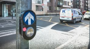 Button to activate pedestrian crossing on the road in Dublin. Dublin, Ireland - February 11, 2019: Button to activate pedestrian crossing on the road on a stock photo