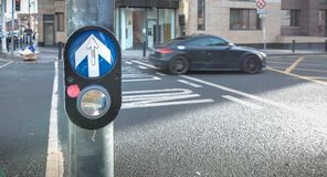 Button to activate pedestrian crossing on the road in Dublin. Dublin, Ireland - February 11, 2019: Button to activate pedestrian crossing on the road on a royalty free stock photography