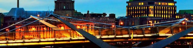 Illuminated Sean O`Casey Bridge with the Custom House in Dublin, Ireland at night. Dublin, Ireland. Illuminated Sean O`Casey Bridge with the Custom House in Stock Photo