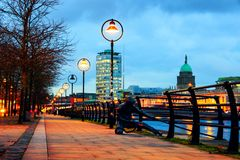 Illuminated Sean O`Casey Bridge with the Custom House in Dublin, Ireland Stock Photo