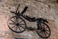 Old Jameson Distillery, Dublin. DUBLIN, IRELAND - JULY 12, 2016: Bycicle in the Old Jameson Distillery, Smithfield Square in Dublin, Ireland. The original site stock photography