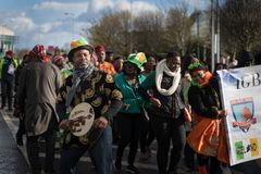Dublin, Ireland 17 March 2019 St Patrics Day Parade. African community in traditional Nigerian costumes celebrating St. Patrics Day on a parade in Dublin royalty free stock photo