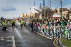 Dublin, Ireland 17 March 2019 St Patrics Day Parade. Croud watching African community in traditional Nigerian costumes celebrating St. Patrics Day on a parade in stock photos