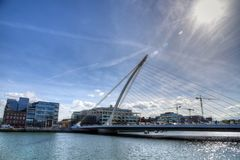 The Samuel Beckett Bridge in Dublin, Ireland. DUBLIN, IRELAND - MAY 30, 2017: The Samuel Beckett Bridge over the river Liffey royalty free stock photo