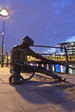 Dublin The Linesman statue. The Linesman statue situated on the bank of the River Liffey in Dublin, Ireland Royalty Free Stock Image