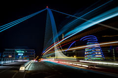 Dublin by night. Harp bridge in Dubliny with cars passiing through by night Royalty Free Stock Photos
