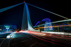 Dublin by night. Harp bridge in Dubliny with cars passiing through by night Stock Image