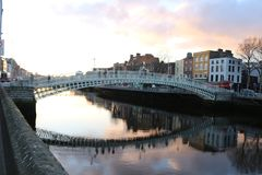 Dublin night scene with Ha`penny bridge and Liffey river lights . Ireland Stock Photo