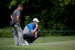 DUBLIN, OH, UNITED STATES - May 29, 2013: Justin Rose and Coach Sean Foley