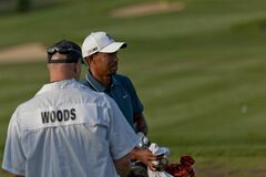 DUBLIN, OH, UNITED STATES - May 29, 2013: Tiger Woods with Caddie