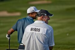DUBLIN, OH, UNITED STATES - May 29, 2013: Tiger Woods with Caddy