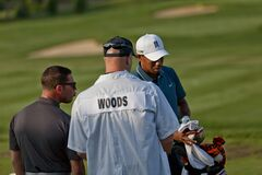 DUBLIN, OH, UNITED STATES - May 29, 2013: Tiger Woods with Coach & Caddy
