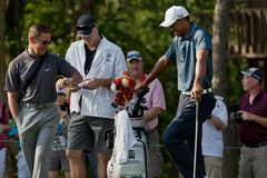 DUBLIN, OH, UNITED STATES - May 29, 2013: Tiger Woods With Coach and Caddy