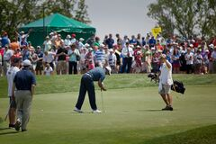 DUBLIN, OH, UNITED STATES - May 29, 2013: Tiger Woods on Green with Caddie