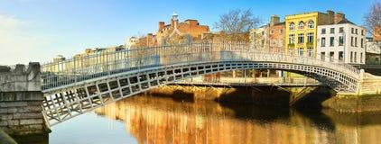 Dublin, panoramic image of Half penny bridge. Or Ha`penny bridge, on a bright day stock photography