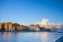 Dublin quay. Sunny evening at Dublin Liffey quay with new harp bridge od the right Royalty Free Stock Photos