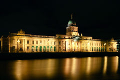 Dublin's Custom House. The famous Custom House in Dublin, pictured at night time with the lights reflecting in the river Liffey Stock Photography
