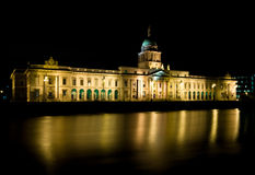 Dublin's Custom House. The famous Custom House in Dublin, pictured at night time with the lights reflecting in the river Liffey Royalty Free Stock Photography