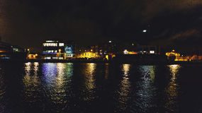 Dublin`s docklands on the river Liffey by night Royalty Free Stock Photography
