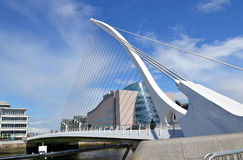 Dublin-Samuel Beckett Bridge & Convention Center. DUBLIN, IRELAND - MAY 12, 2011: The Samuel Beckett Bridge and Convention Center. The bridge joins Sir John royalty free stock image