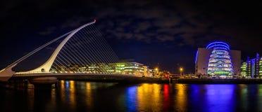 Dublin Samuel Beckett Bridge night view. Panorama of Dublin by night. River with citylights reflections. Samuel Beckett Bridge Royalty Free Stock Image