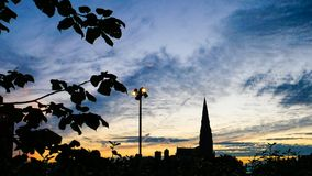 Dublin Skyline silhouette at sunset St. Laurence O`Toole church. Dublin Skyline silhouette at sunset with steeple of St. Laurence O`Toole Catholic church against stock photography