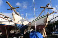 Dublin Yachts. Equipment Canon EOS400D. Two old yachts with wooden hulls in dry dock for the winter months. This shot was taken in Dun Laoghaire, a small port Royalty Free Stock Image