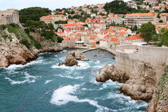 Dubrovnik. Bokar Tower of Dubrovnik and its harbor, with the old town in the background Royalty Free Stock Photo