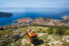 Dubrovnik cable car moving down to the city Stock Photo