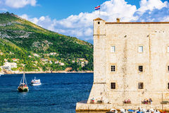 Dubrovnik castle wall with boats coming into the Harbor Royalty Free Stock Image