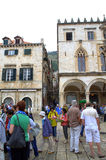 Dubrovnik city tourists. Tourists sightseeing on square in the walled  city of Dubrovnik,Croatia.Dubrovnik is a city in southern Croatia fronting the Adriatic Royalty Free Stock Photo