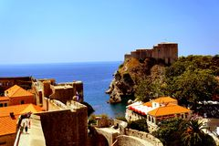 Dubrovnik city wall Croatia. Coming upper and upper it is nice to enjoy magnificent view of old city of Dubrovnik including gorgeous scenery the sea bay with stock photo