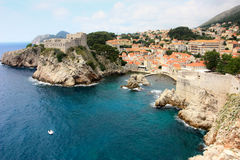 Dubrovnik coastline. The rocky coastline of the old city of Dubrovnik and its city walls Stock Photo